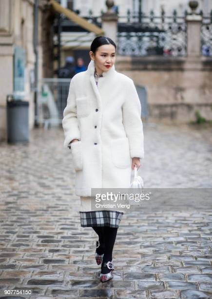 Sherry Shen wearing white coat is seen outside Thom Browne on January 20 2018 in Paris France