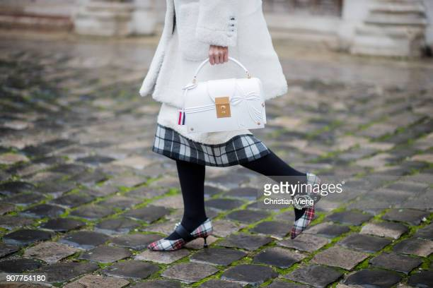 Sherry Shen wearing white coat white Thom Browne bag is seen outside Thom Browne on January 20 2018 in Paris France