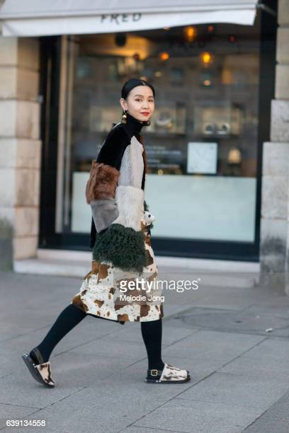 Sherry Shen wears Marni and carries a Loewe panda coin purse outside the Balenciaga show at Place Vendome on January 18 2017 in Paris France