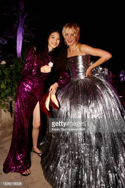 Sherry Shi and Evie Harris attend the amfAR Cannes Gala 2021 at Villa Eilenroc on July 16, 2021 in Cap d'Antibes, France.