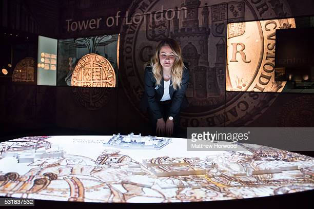 Sherry Thomas of the Royal Mint Experience looks at an interactive display during the opening of the Royal Mint Experience at the Royal Mint on May...