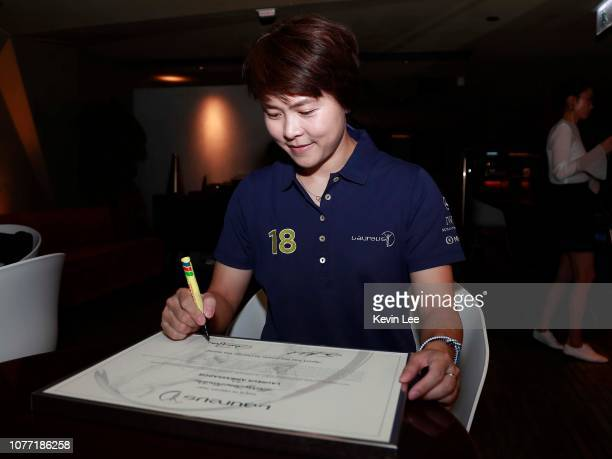 Sherry Tsai Hiu Wai signs on the certificate before the Laureus Hong Kong Ambassador Announcement ceremony at Mercedes Me Store on December 04 2018...