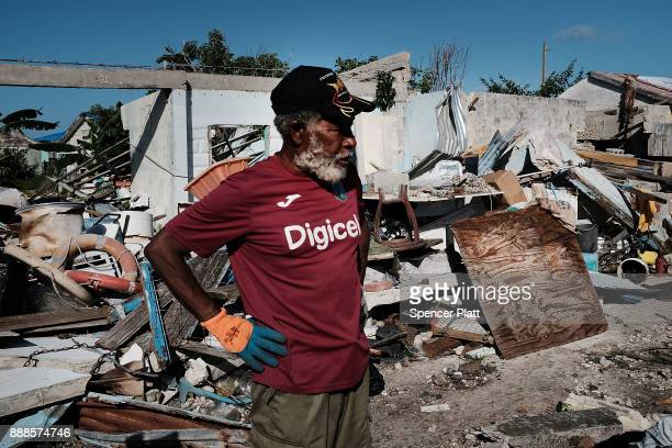 Sherwan Webber stands amongst the debris of his home on the nearly destroyed island of Barbuda on December 8 2017 in Cordington Barbuda Barbuda which...