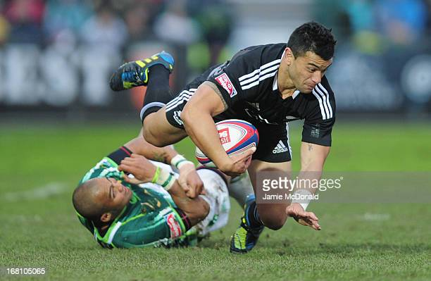 Sherwin Stowers of New Zealand is tackled by Cornal Hendricks of South Africa during the Cup Final match during day two of the IRB Glasgow Sevens at...