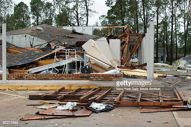 SherwinWilliams paint store in Port Arthur Tex lies in ruins after the town took a direct hit from Hurricane Rita which pummeled East Texas and the...