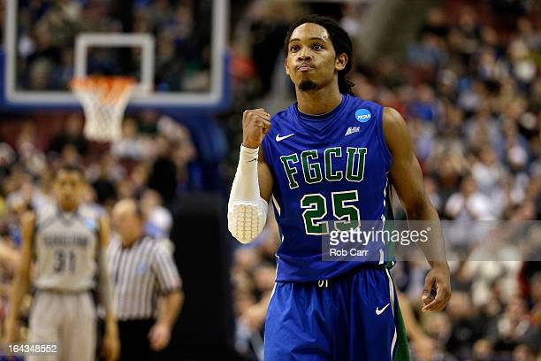 Sherwood Brown of the Florida Gulf Coast Eagles celebrates late in the second half against the Georgetown Hoyas during the second round of the 2013...
