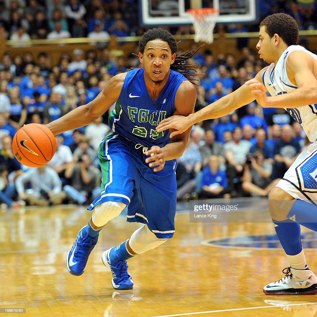 Sherwood Brown #25 of the Florida Gulf Coast Eagles dribbles against Seth Curry #30 of the Duke Blue Devils at Cameron Indoor Stadium on November 18, 2012 in Durham, North Carolina. Duke defeated Florida Gulf Coast 88-67.
