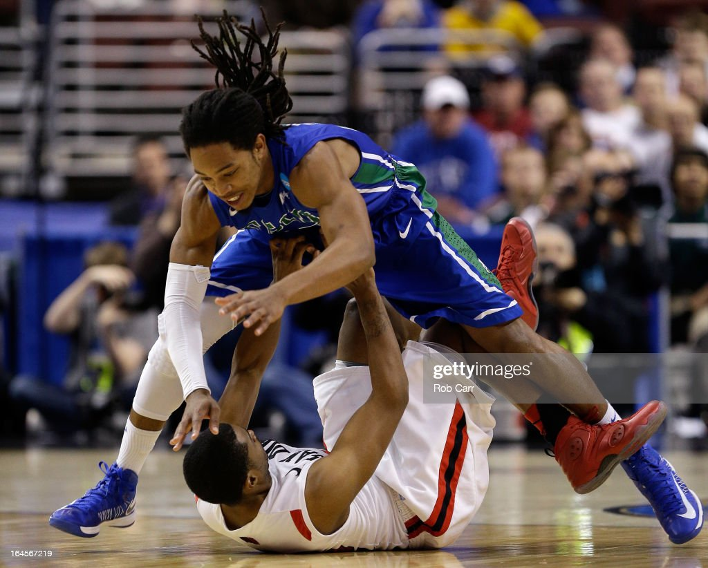 Sherwood Brown #25 of the Florida Gulf Coast Eagles fouls Chase Tapley #22 of the San Diego State Aztecs in the first half during the third round of the 2013 NCAA Men's Basketball Tournament at Wells Fargo Center on March 24, 2013 in Philadelphia, Pennsylvania.