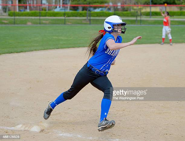 Sherwood's Hanna Nalls rounds third heading home for heir team's 2nd run on Sherwood's Julie Swarr's 7th inning 2 out 2 run RBI game winning triple...