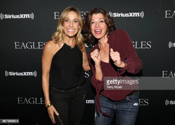Sheryl Crow and Amy Grant attend SiriusXM presents the Eagles in their first ever concert at the Grand Ole Opry House on October 29 2017 in Nashville...