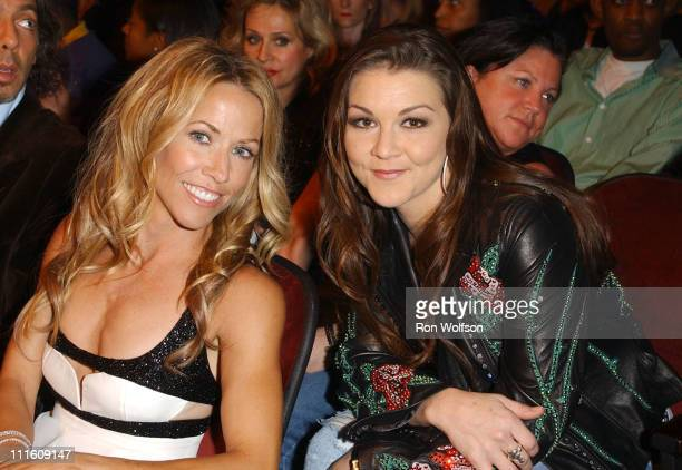 Sheryl Crow and Gretchen Wilson during 32nd Annual American Music Awards Backstage and Audience at Shrine Auditorium in Los Angeles California United...