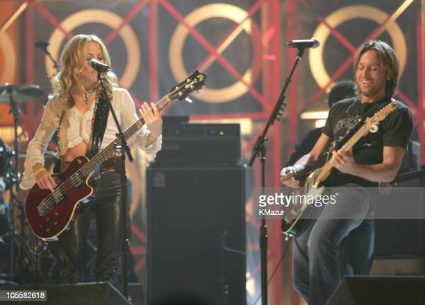 Sheryl Crow and Keith Urban perform Days Go By during 2004 Billboard Music Awards Show at MGM Grand Garden in Las Vegas Nevada United States