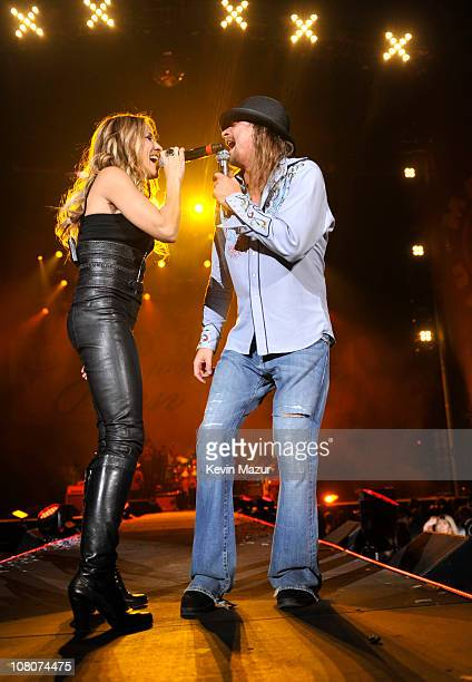 """Sheryl Crow and Kid Rock perform during his """"Born Free"""" tour opener at Ford Field on January 15, 2011 in Detroit, Michigan."""
