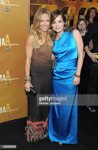 Sheryl Crow and Kimberly Williams Paisley attends the 44th Annual CMA Awards at the Bridgestone Arena on November 10 2010 in Nashville Tennessee