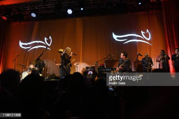 Sheryl Crow and Michael J Fox perform on stage at A Funny Thing Happened On The Way To Cure Parkinson's benefitting The Michael J Fox Foundation on...