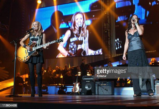 Sheryl Crow and Sarah McLachlan during The Andre Agassi Charitable Foundation's 8th 'Grand Slam for Children' Fundraiser Show at The MGM Grand Hotel...