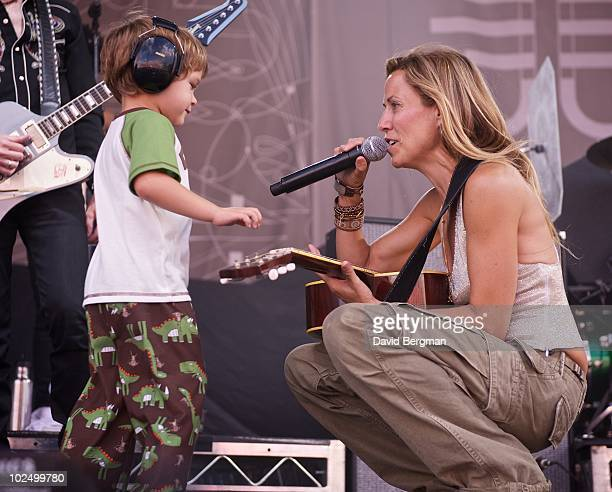 Sheryl Crow is joined by her son Wyatt as she performs at the 2010 Lilith Fair at McMahon Stadium on June 27 2010 in Calgary Canada