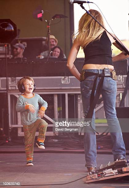Sheryl Crow is joined on stage by her son at Lilith 2010 at the Gorge Amphitheater on July 3 2010 in George Washington
