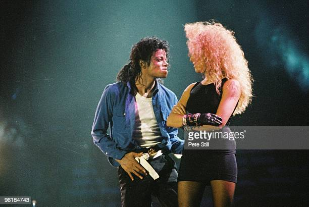 Sheryl Crow joins Michael Jackson to perform on stage on his BAD tour at Wembley Stadium on 23rd July 1988 in London, United Kingdom.