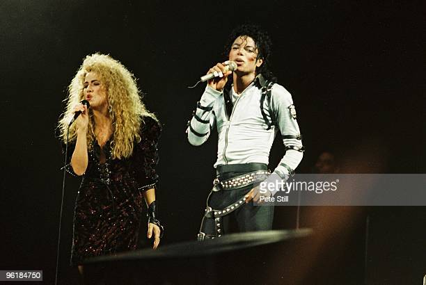 Sheryl Crow joins Michael Jackson to perform on stage on his BAD tour at Wembley Stadium on 23rd July 1988 in London United Kingdom
