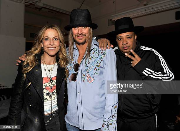 """Sheryl Crow, Kid Rock and Joseph """"Rev Run"""" Simmons backstage at Ford Field on January 15, 2011 in Detroit, Michigan."""