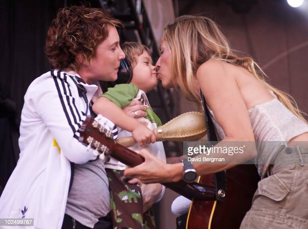Sheryl Crow kisses her son Wyatt as she performs at the 2010 Lilith Fair at McMahon Stadium on June 27, 2010 in Calgary, Canada.