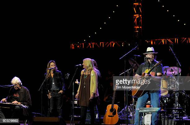 Sheryl Crow Pegi Young and Neil Young perform the Finale of the 23rd Annual Bridge School Benefit at Shoreline Amphitheatre on October 24 2009 in...