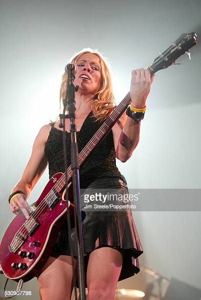 Sheryl Crow performing on stage at Wembley Arena in London on the 23rd June 2004