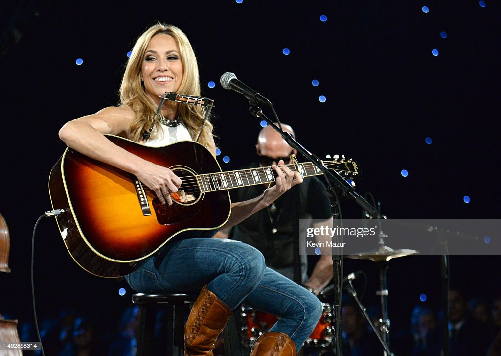 Sheryl Crow performs onstage at the 25th anniversary MusiCares 2015 Person Of The Year Gala honoring Bob Dylan at the Los Angeles Convention Center on February 6, 2015 in Los Angeles, California. The annual benefit raises critical funds for MusiCares' Emergency Financial Assistance and Addiction Recovery programs. For more information visit musicares.org.