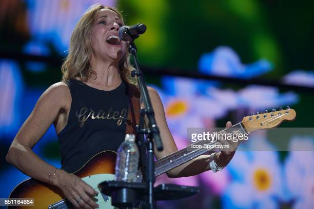 Sheryl Crow sings a song while playing guitar during a concert at Farm Aid 2017 on September 16 2017 at Keybank Pavilion in Hanover Township PA