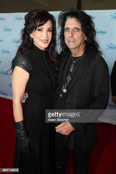 Sheryl Goddard and Alice Cooper walk the red carpet at the 2018 So the World May Hear Awards Gala benefitting Starkey Hearing Foundation at the Saint...