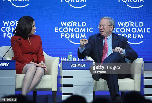 Sheryl Sandberg billionaire and chief operating officer of Facebook Inc left listens as Eric Schmidt chairman of Google Inc speaks during a session...