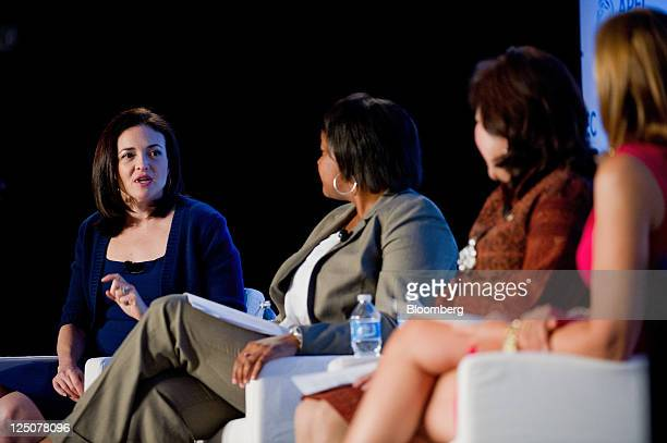 Sheryl Sandberg chief operating officer of Facebook Inc from left speaks as Danielle Gray deputy director of the National Economic Council Mari...