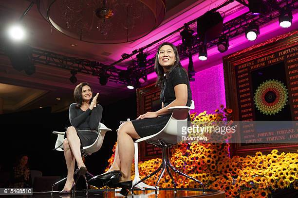 Sheryl Sandberg chief operating officer of Facebook Inc left applauds as Priscilla Chan cofounder of the Chan Zuckerberg Initiative LLC smiles during...