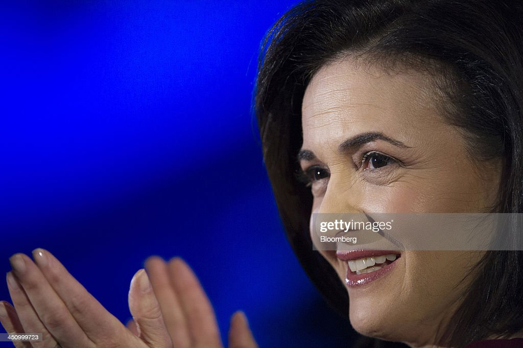 Sheryl Sandberg, chief operating officer of Facebook Inc., reacts during a demonstration at the DreamForce Conference in San Francisco, California, U.S., on Wednesday, Nov. 20, 2013. Salesforce.com Inc. introduced an overhauled version of its mobile software, seeking to ensure clients and partners will be able to use more features of the company's sales, marketing and customer service software. Photographer: David Paul Morris/Bloomberg via Getty Images