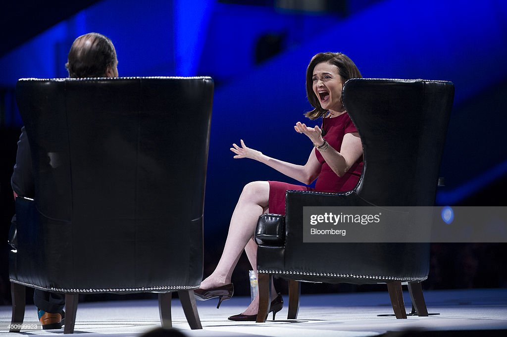 Sheryl Sandberg, chief operating officer of Facebook Inc., right, reacts while speaking with Marc Benioff, chairman and chief executive officer of Salesforce.com Inc., during the DreamForce Conference in San Francisco, California, U.S., on Wednesday, Nov. 20, 2013. Salesforce.com Inc. introduced an overhauled version of its mobile software, seeking to ensure clients and partners will be able to use more features of the company's sales, marketing and customer service software. Photographer: David Paul Morris/Bloomberg via Getty Images