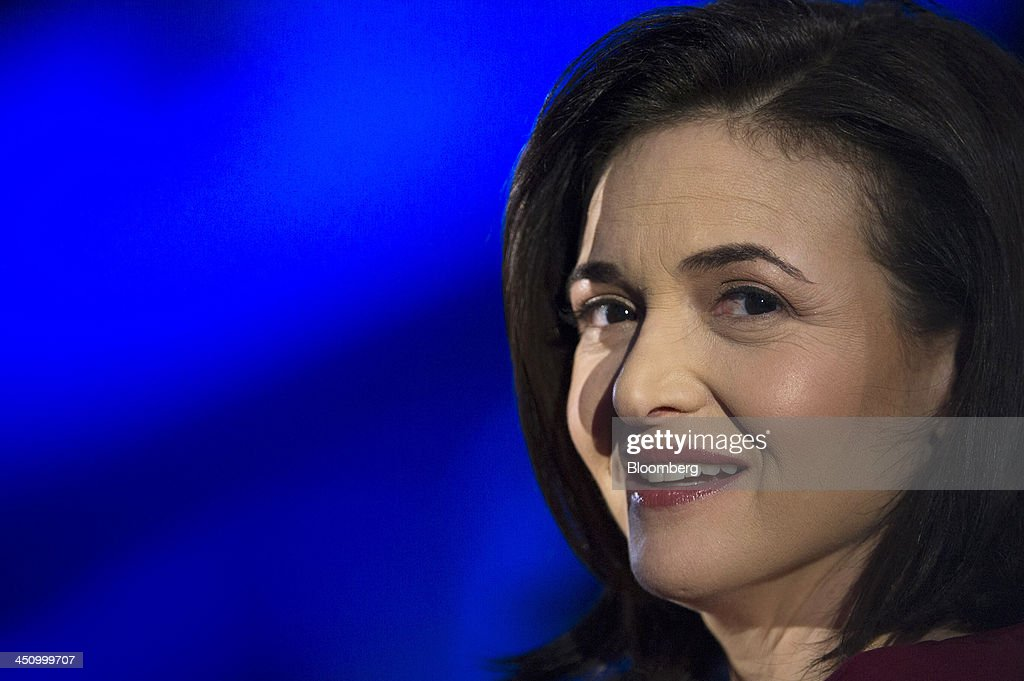Sheryl Sandberg, chief operating officer of Facebook Inc., watches a demonstration at the DreamForce Conference in San Francisco, California, U.S., on Wednesday, Nov. 20, 2013. Salesforce.com Inc. introduced an overhauled version of its mobile software, seeking to ensure clients and partners will be able to use more features of the company's sales, marketing and customer service software. Photographer: David Paul Morris/Bloomberg via Getty Images