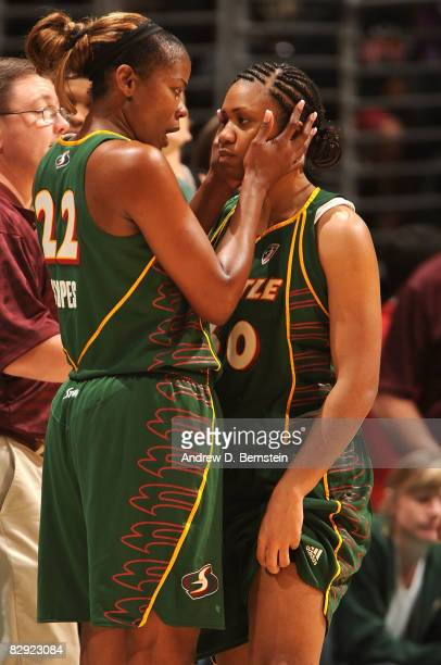 Sheryl Swoopes and Tanisha Wright of the Seattle Storm talk on the sidelines during a time out against the Los Angeles Sparks during Game One of the...