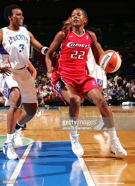 Sheryl Swoopes of the Houston Comets drives against Crystal Robinson of the New York Liberty July 27 2005 at Madison Square Garden in New York New...