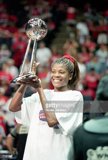 Sheryl Swoopes of the Houston Comets holds up her trophy after winning the WNBA Finals Game against the New York Liberty on August 26, 2000 at the...