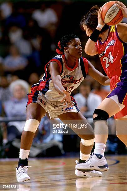 Sheryl Swoopes of the Houston Comets plays defense against the Phoenix Mercury during a game played August 7 1997 at the Compaq Center in Houston...
