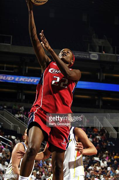 Sheryl Swoopes of the Houston Comets shoots against the Phoenix Mercury in WNBA action August 25 2005 at America West Arena in Phoenix Arizona NOTE...