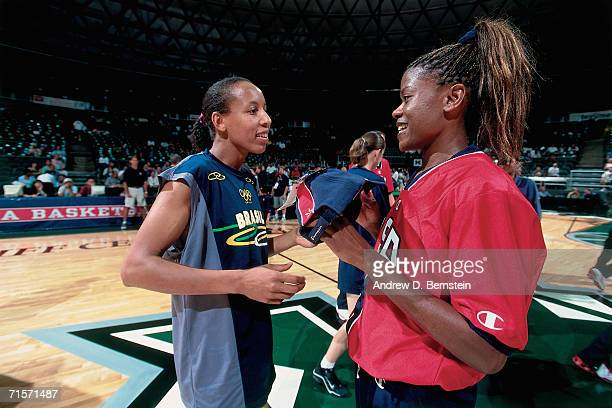 Sheryl Swoopes of the United States Women's National Team talks with Janeth Arcain of the Brazilian Women's National Team during the 1999-2000...
