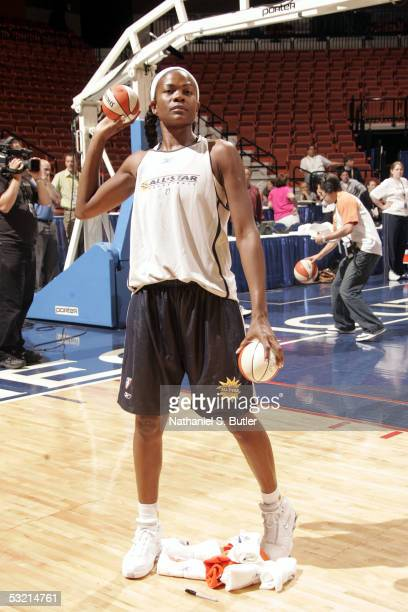 Sheryl Swoopes of the Western Conference AllStars throws balls into the stands during the 2005 WNBA AllStarPractice on July 8 2005 at Mohegan Sun...