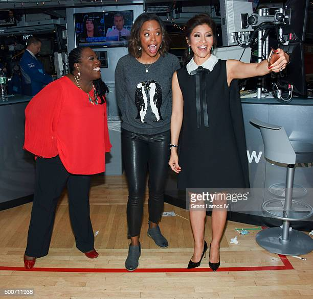 Sheryl Underwood Aisha Tyler and Julie Chen of CBS' 'The Talk' ring the closing bell at the New York Stock Exchange on December 9 2015 in New York...