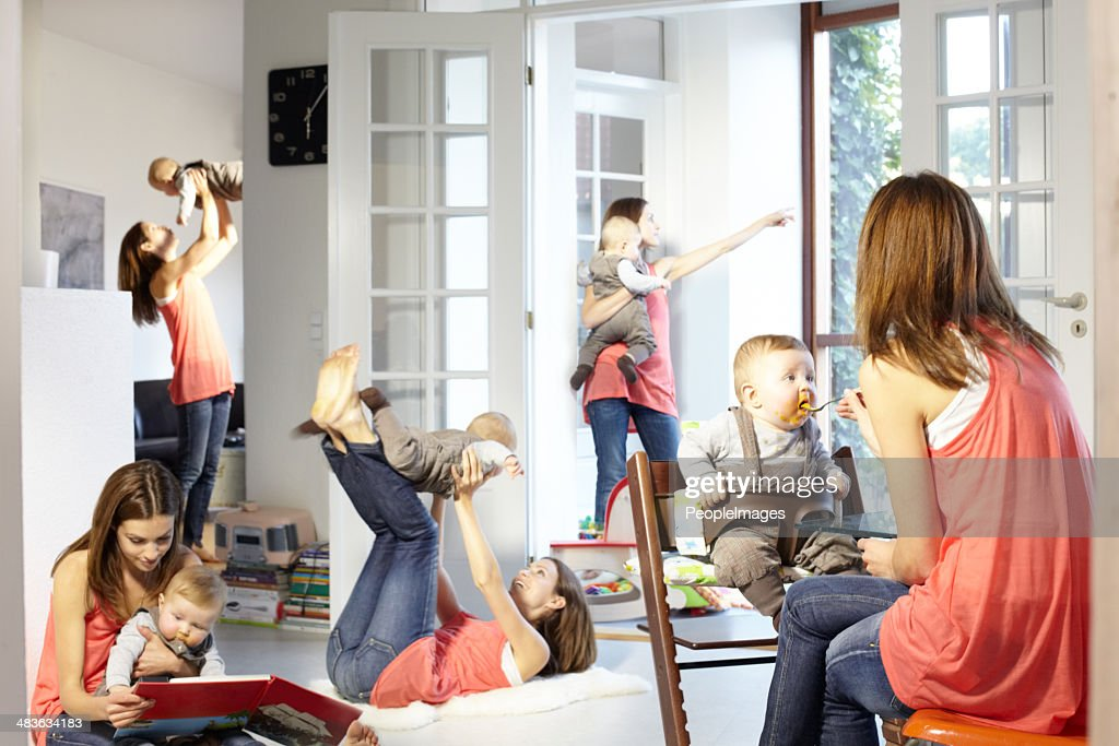 She's a busy mom! : Stock Photo