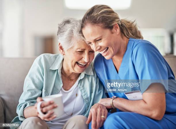 she's a caregiver and companion - carers stock photos and pictures