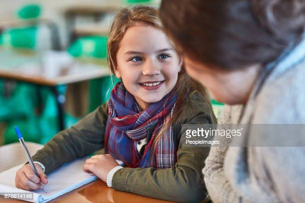 she's a great teacher - primary age child stock pictures, royalty-free photos & images