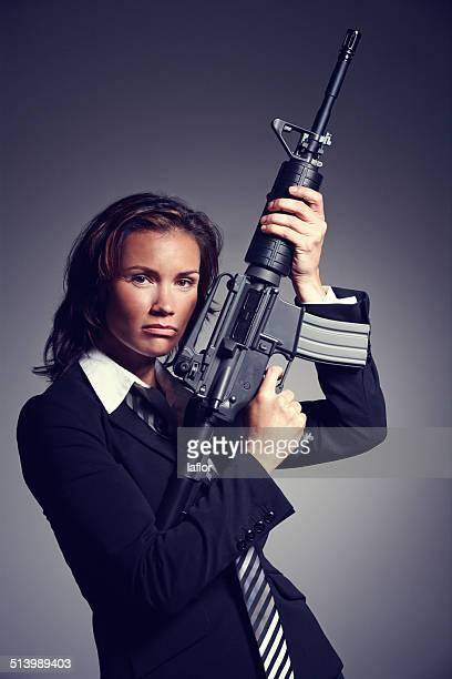 ela é a inexorável manager - metralhadora imagens e fotografias de stock