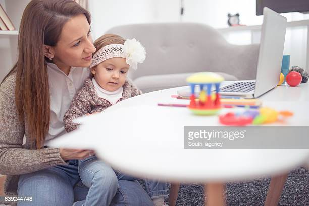 she's a multi-tasking mom - very young webcam girls stock photos and pictures